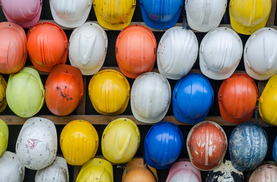 Construction helmets hanging on a wall