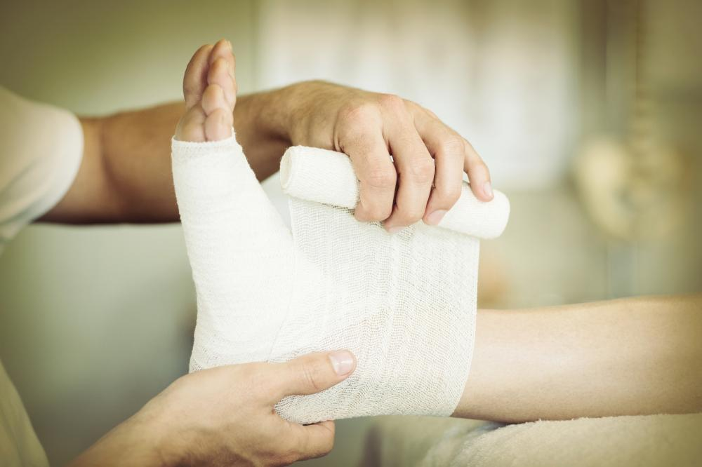 Person getting their foot wrapped in a bandage