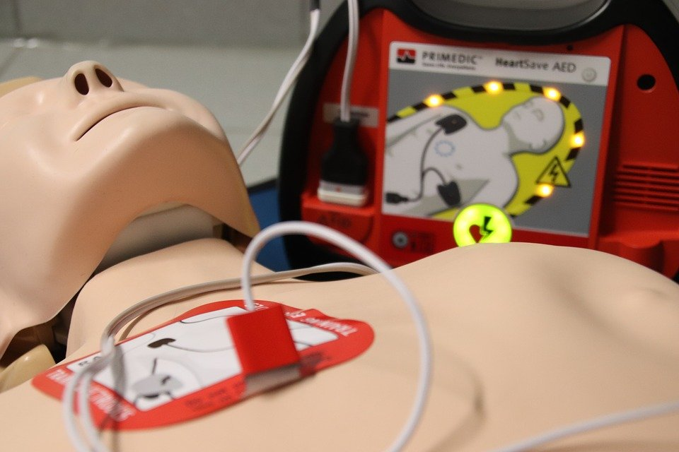 First aid treatment for CPR administered on a doll