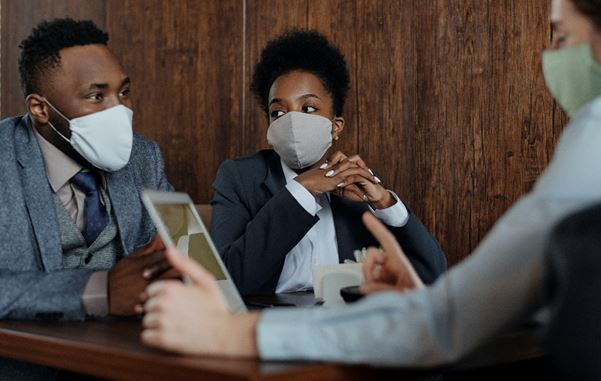People talking to each other while wearing face masks